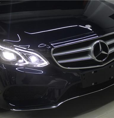 奔驰E260大灯升级高配原装LED大灯总成 上海蓝精灵专业改大灯升级电脑编程