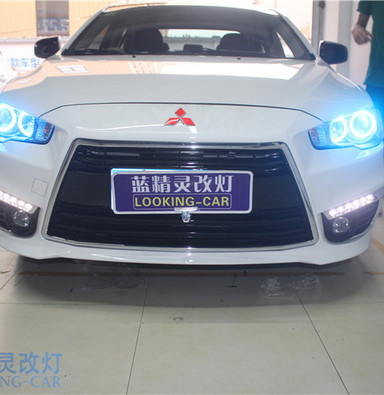 三菱翼神改装四天使眼大灯 上海改装双光透镜 蓝精灵改装氙气车灯