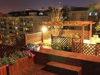 【屋顶花园】---没有固定风格。自然优美。市区天屋顶花园全程施工经典个例。休闲与实用的代表作