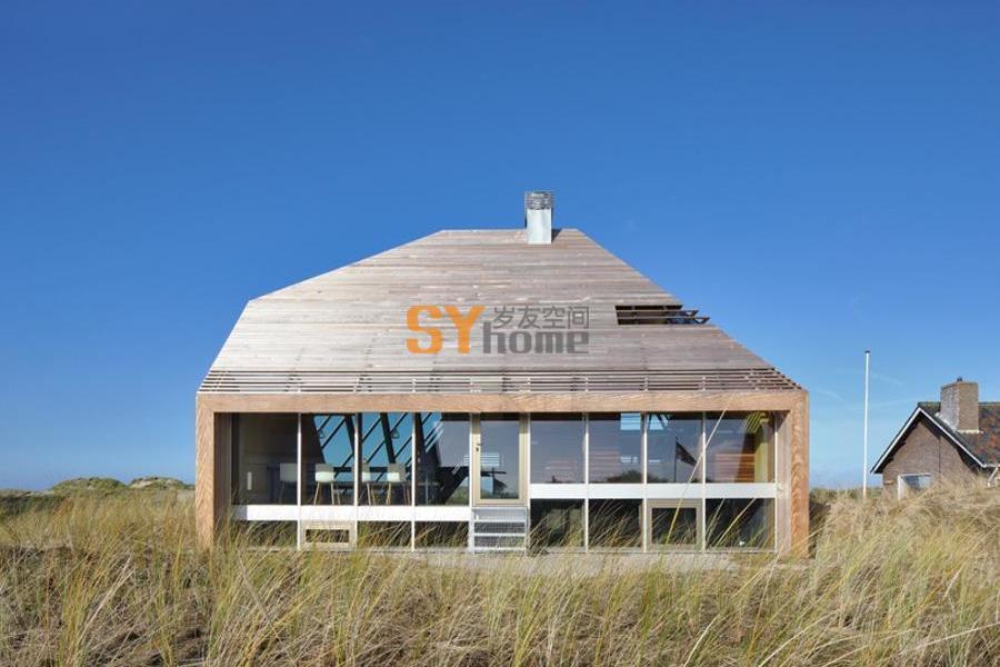 嵌入地貌景观中的沙丘住宅