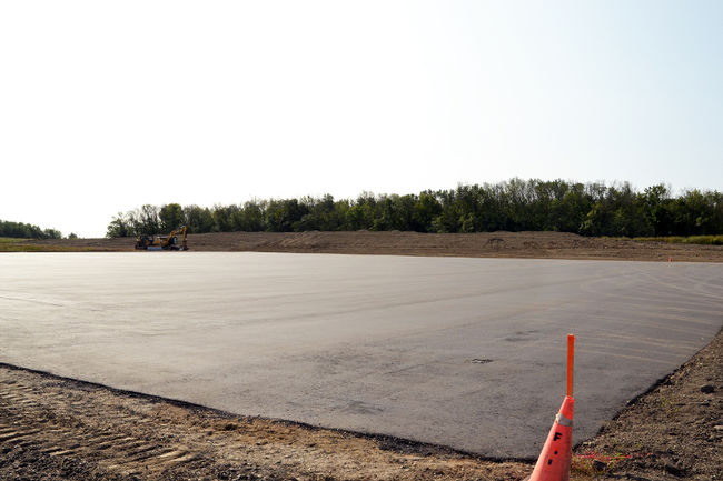 A large asphalt pad has been laid down this week as part of Renesas Electronics America's construction of an autonomous vehicle test track on Lorne Avenue at Romeo Street. (Galen Simmons/The Beacon Herald)