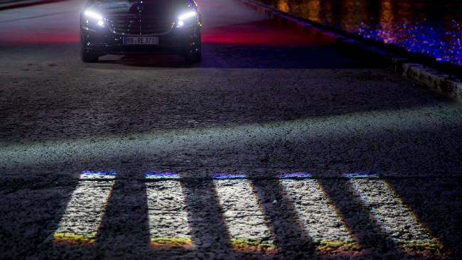 The experimental Mercedes can also project a temporary crossing onto the road, to let pedestrians know the car is prepared to wait for them to cross safely. Picture: Supplied.