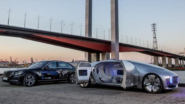 Mercedes F015 concept car of the future (right) meets the car of today (left) after Mercedes tests a partially autonomous car from Sydney to Melbourne. Picture: Supplied.