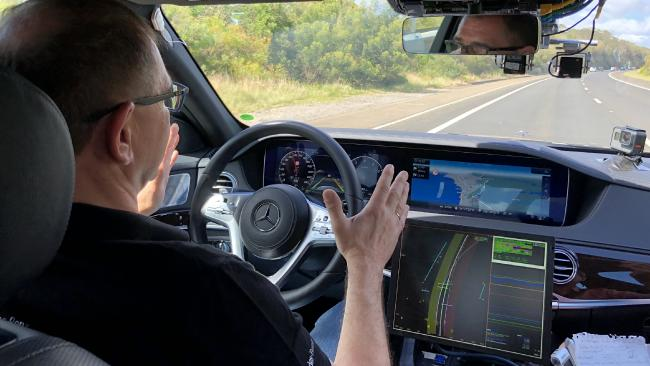 Senior Mercedes engineer Jochen Haab tests the hands-free function. Picture: Joshua Dowling.