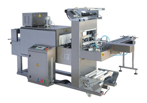 Automatic cuff type heat shrink packaging machine
