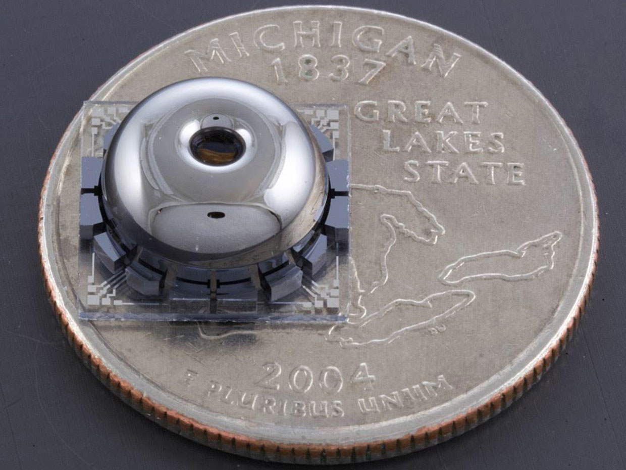 The new resonator and electrodes, on a quarter for scale.