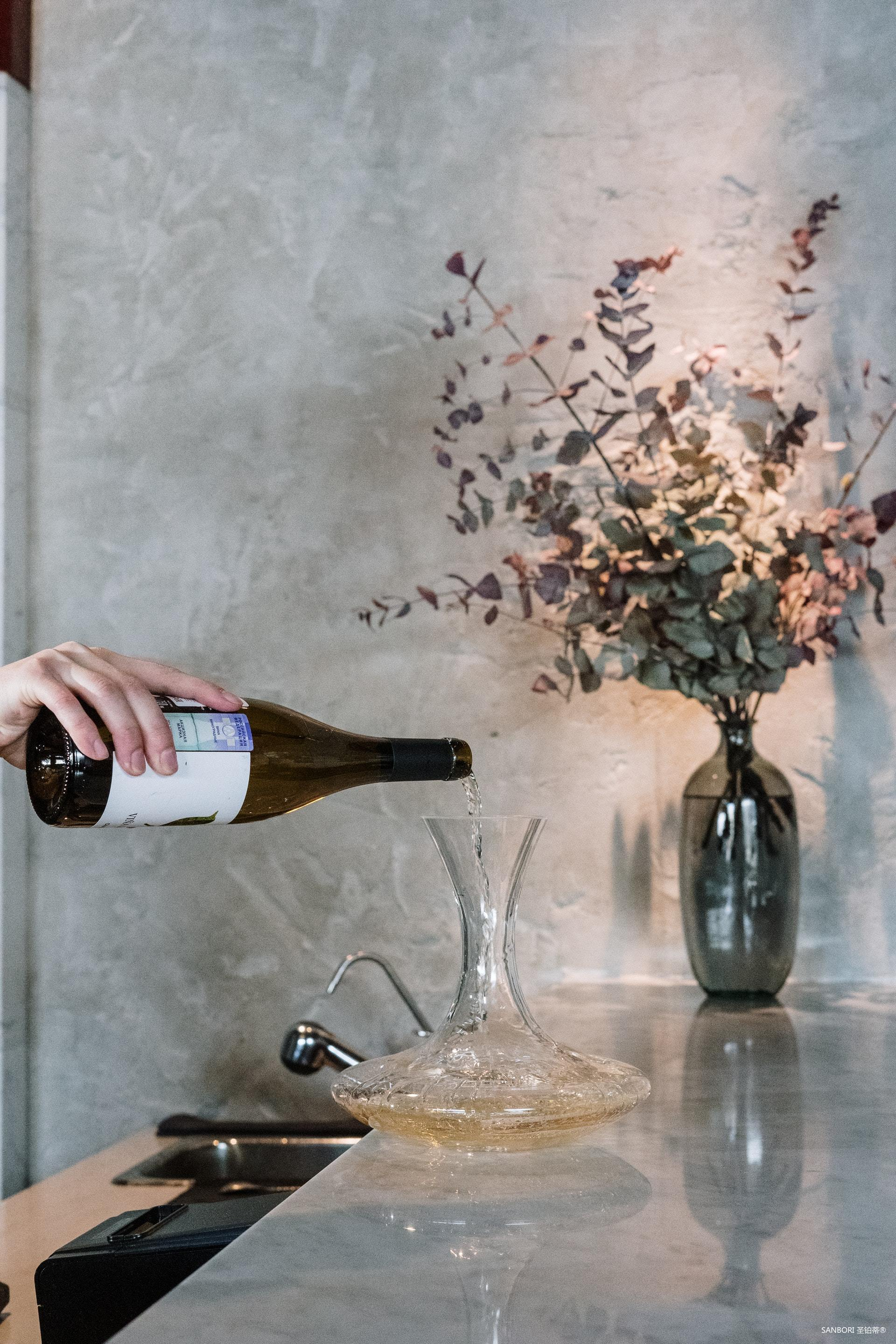 person-pouring-wine-on-clear-glass-bottle-4254021.jpg