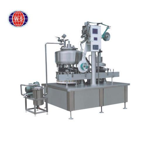 Filling and aluminum foil sealing machine