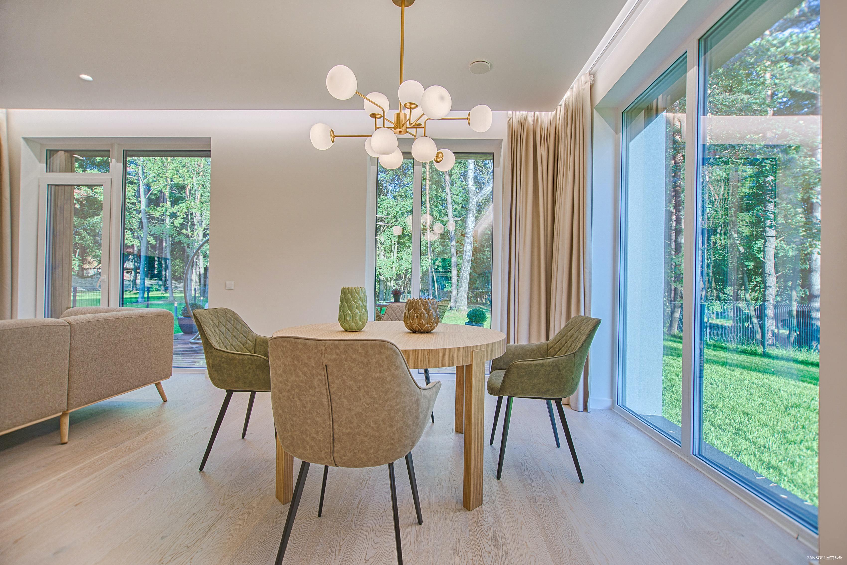 round-brown-wooden-5-piece-dining-set-in-room-1571463.jpg