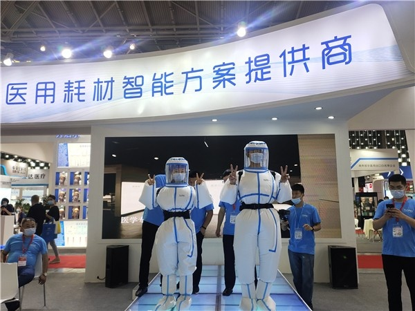 驼人集团医用正压防护服在上海国际防疫物资展览会中上市-中国商网|中国商报社0