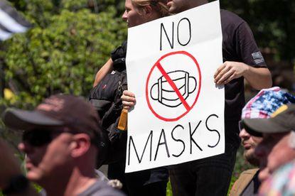 """科学政治化或在继续?""""口罩强制令""""在美国推行受阻"""